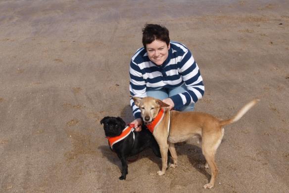 Anna on beach with dogs