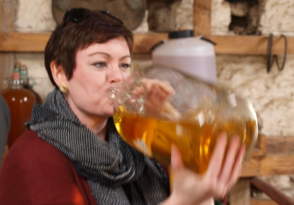 drinking cider from a demijohn